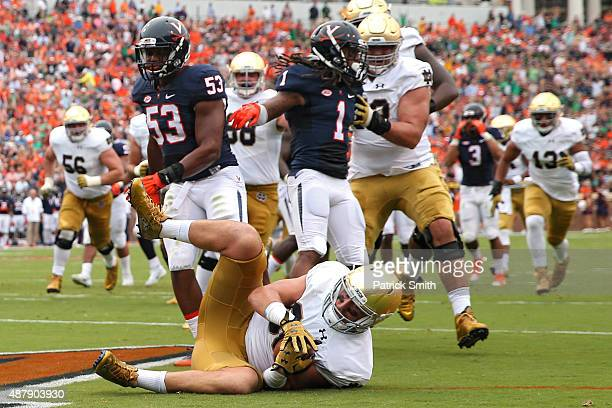 Tight end Durham Smythe of the Notre Dame Fighting Irish scores a touchdown on a fake field goal attempt in the first quarter against the Virginia...