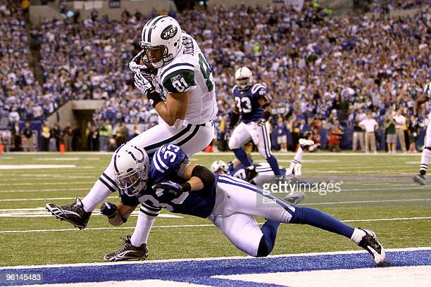 Tight end Dustin Keller of the New York Jets catches a nineyard second quarter touchdown catch against Raheem Brock of the Indianapolis Colts during...