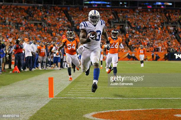Tight end Dwayne Allen of the Indianapolis Colts runs the ball into the end zone with a 41yard fourth quarter touchdown against the Denver Broncos at...