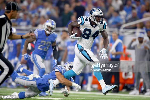 Tight end Ed Dickson of the Carolina Panthers runs for yardage against strong safety Miles Killebrew of the Detroit Lions during the first half at...