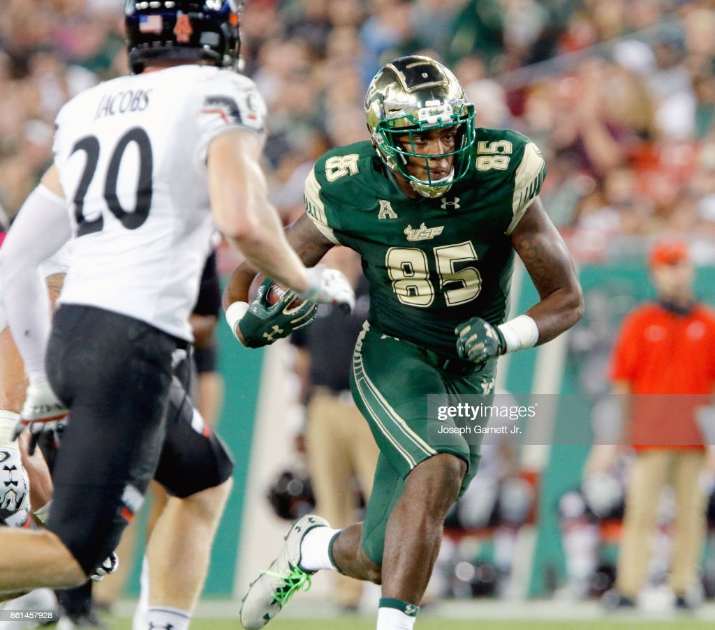 Tight end Elkanah Dillon #85 of the South Florida Bullsruns down the center of the field after catching a pass against the Cincinnati Bearcats during the third quarter of their game at Raymond James Stadium on October 14, 2017 in Tampa, Florida.