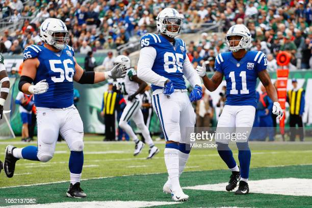 Tight end Eric Ebron of the Indianapolis Colts celebrates his touchdown as teammates wide receiver Ryan Grant and offensive guard Quenton Nelson look...