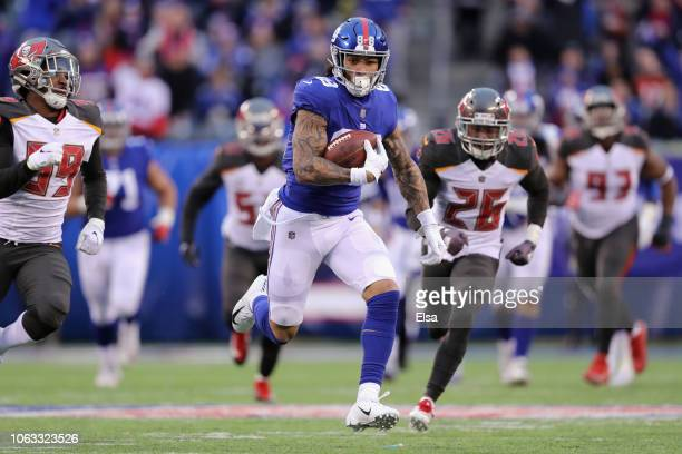 Tight end Evan Engram of the New York Giants carries the ball for a first down against the Tampa Bay Buccaneers during the fourth quarter at MetLife...