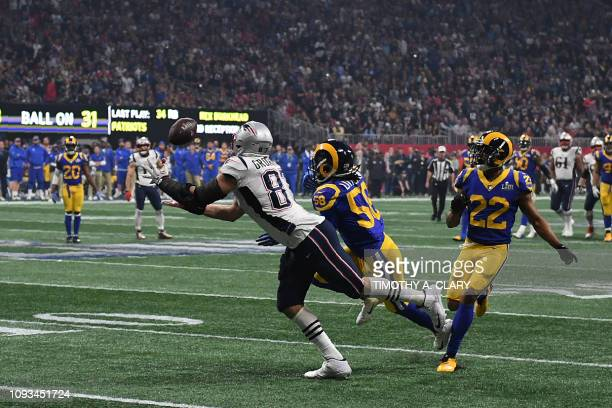 Tight end for the New England Patriots Rob Gronkowski tries to make a catch during Super Bowl LIII between the New England Patriots and the Los...