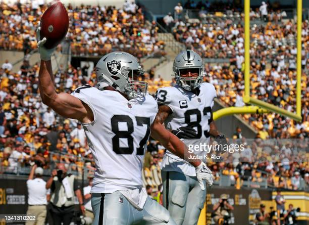 Tight end Foster Moreau of the Las Vegas Raiders prepares to spike the ball in celebration of his touchdown against the Pittsburgh Steelers in the...
