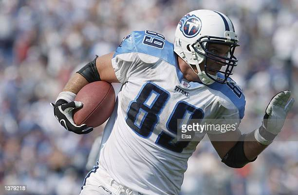 Tight end Frank Wycheck of the Tennessee Titans runs with the ball during the NFL game against the Philadelphia Eagles on September 8 2002 at the...