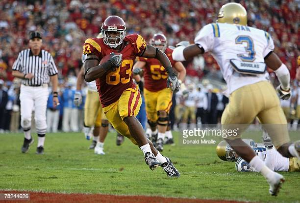 Tight end Fred Davis of the USC Trojans scores on a 12 yard touchdown reception against the UCLA Bruins during the fourth quarter of the college...