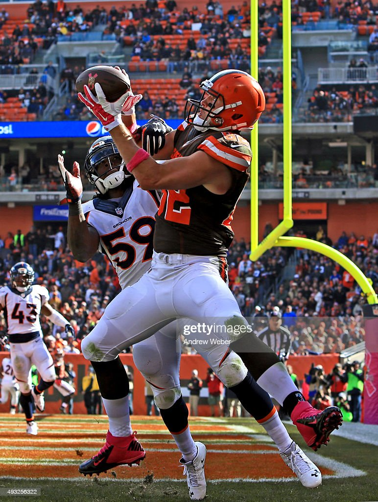 Tight end Gary Barnidge #82 of the Cleveland Browns catches a pass for a touchdown while being defended by inside linebacker Danny Trevathan #59 of the Denver Broncos during the third quarter at Cleveland Browns Stadium on October 18, 2015 in Cleveland, Ohio.