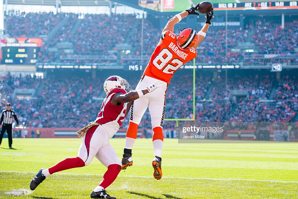 Tight end Gary Barnidge #82 of the Cleveland Browns catches a touchdown pass while under pressure from strong safety Tony Jefferson #22 of the Arizona Cardinals during the first half at FirstEnergy Stadium on November 1, 2015 in Cleveland, Ohio.