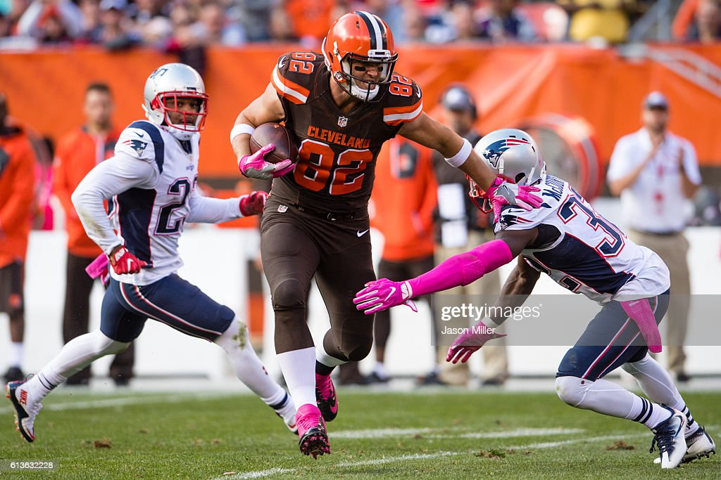 Tight end Gary Barnidge #82 of the Cleveland Browns dodges free safety Devin McCourty #32 of the New England Patriots during the second half at FirstEnergy Stadium on October 9, 2016 in Cleveland, Ohio. The Patriots defeated the Browns 33-13.