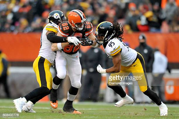 Tight end Gary Barnidge of the Cleveland Browns tries to fight off the tackles of safety Will Allen and linebacker Jarvis Jones of the Pittsburgh...