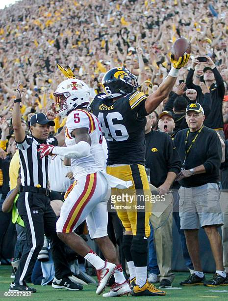 Tight end George Kittle of the Iowa Hawkeyes celebrates after scoring a touchdown during the first quarter in front of defensive back Kamari...