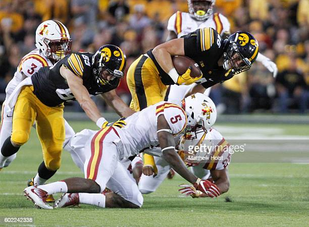 Tight end George Kittle of the Iowa Hawkeyes is brought down during the second quarter by defensive back Kamari CottonMoya and linebacker Brian Mills...