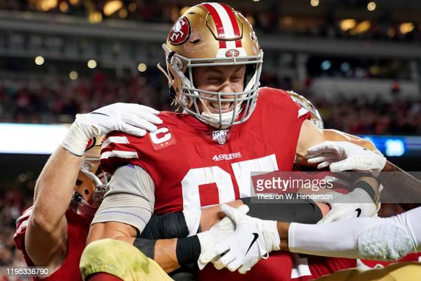 Tight end George Kittle of the San Francisco 49ers and teammates celebrate his fourth quarter touchdown over the Los Angeles Rams at Levi's Stadium...