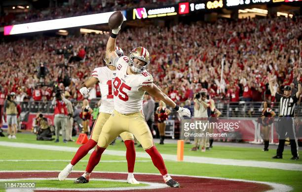 Tight end George Kittle of the San Francisco 49ers celebrates his touchdown in the first quarter over the Arizona Cardinals at State Farm Stadium on...