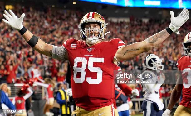 Tight end George Kittle of the San Francisco 49ers celebrates his fourth quarter touchdown over the Los Angeles Rams at Levi's Stadium on December...
