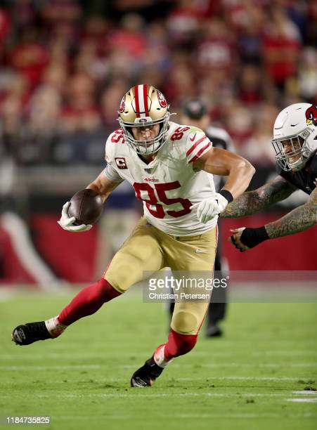 Tight end George Kittle of the San Francisco 49ers completes a reception in the first quarter over the Arizona Cardinals at State Farm Stadium on...