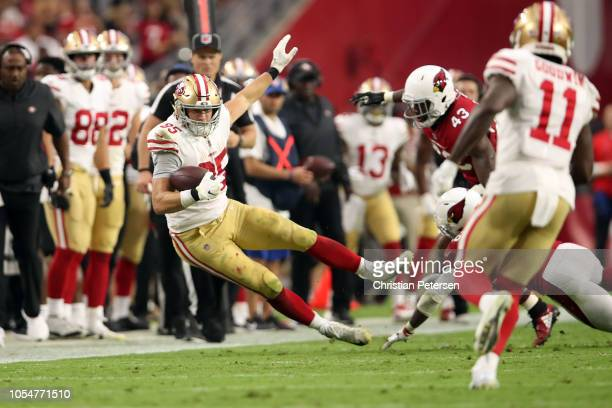 Tight end George Kittle of the San Francisco 49ers is hit out of bounds during the second half against the Arizona Cardinals at State Farm Stadium on...