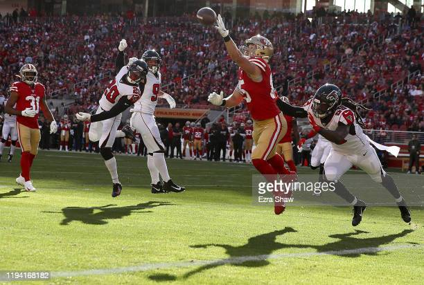 Tight end George Kittle of the San Francisco 49ers is unable to complete a pass against outside linebacker De'Vondre Campbell of the Atlanta Falcons...