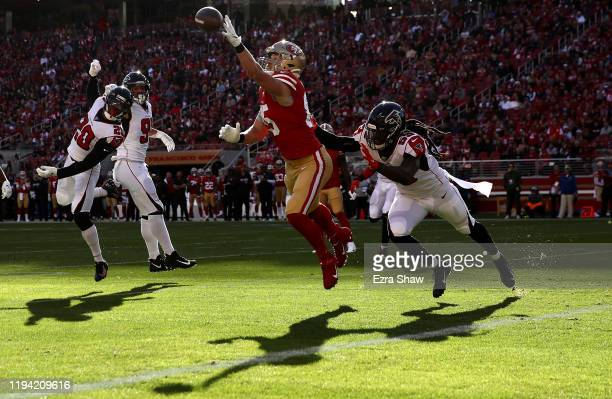 Tight end George Kittle of the San Francisco 49ers is unable to catch a pass against outside linebacker De'Vondre Campbell of the Atlanta Falcons...