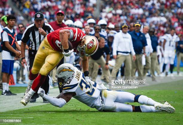 Tight end George Kittle of the San Francisco 49ers makes a first down catch against the Los Angeles Chargers at StubHub Center on September 30 2018...