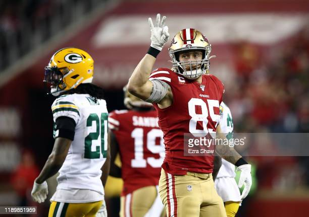 Tight end George Kittle of the San Francisco 49ers reacts after a first down during the first half of the game against the Green Bay Packers at...