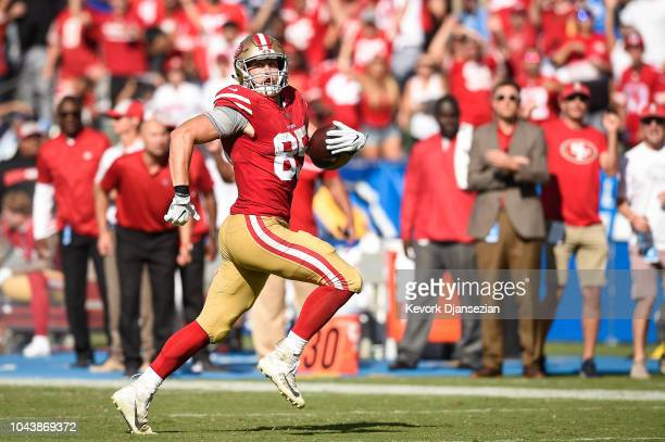 Tight end George Kittle of the San Francisco 49ers runs the ball in for a touchdown in the third quarter against the Los Angeles Chargers at StubHub...