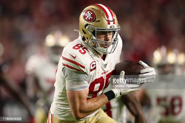 Tight end George Kittle of the San Francisco 49ers runs with the football against the Arizona Cardinals during the first half of the NFL game at...