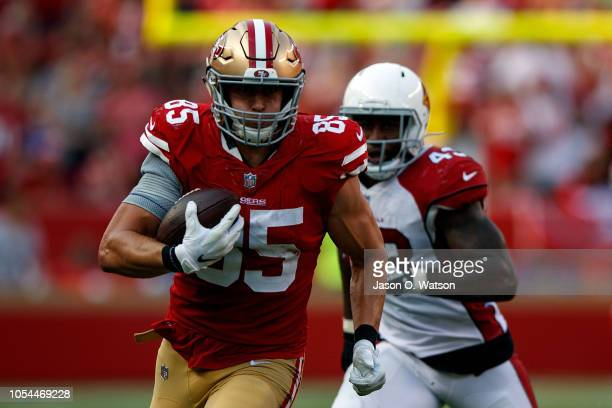 Tight end George Kittle of the San Francisco 49ers rushes up field past linebacker Haason Reddick of the Arizona Cardinals of the Arizona Cardinals...