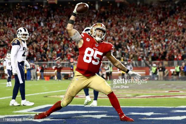 Tight end George Kittle of the San Francisco 49ers spikes the ball after his fourth quarter touchdown over the Los Angeles Rams at Levi's Stadium on...