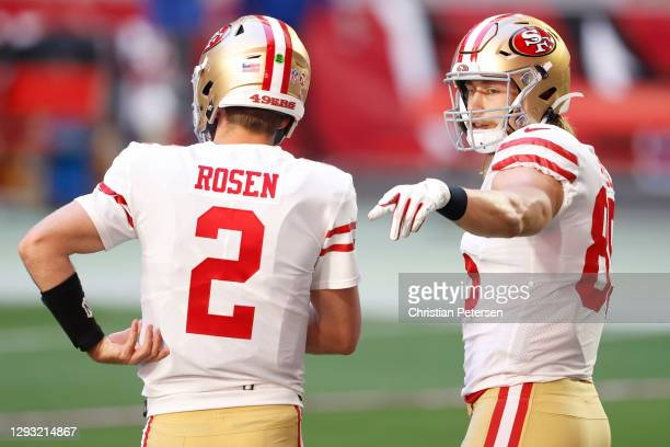 Tight end George Kittle of the San Francisco 49ers talks with quarterback Josh Rosen during warmups before the game against the Arizona Cardinals at...