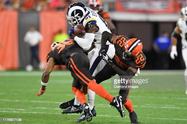 Tight end Gerald Everett of the Los Angeles Rams is hit by defensive back Jermaine Whitehead and strong safety Eric Murray of the Cleveland Browns in...