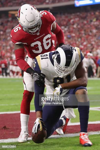 Tight end Gerald Everett of the Los Angeles Rams scores a touchdown over safety Budda Baker of the Arizona Cardinals during the first quarter of the...