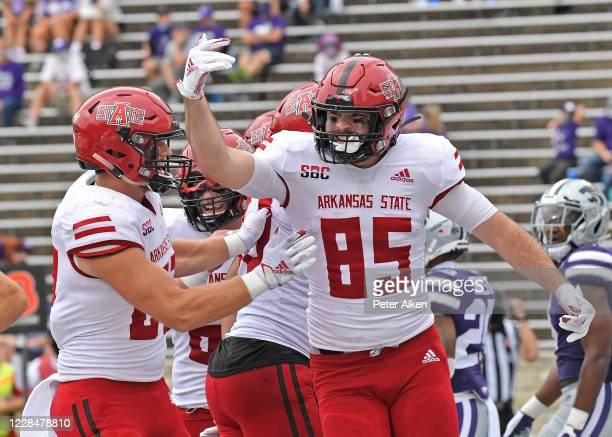 Tight end Giles Amos of the Arkansas State Red Wolves celebrates after catching a touchdown pass against the Kansas State Wildcats during the second...
