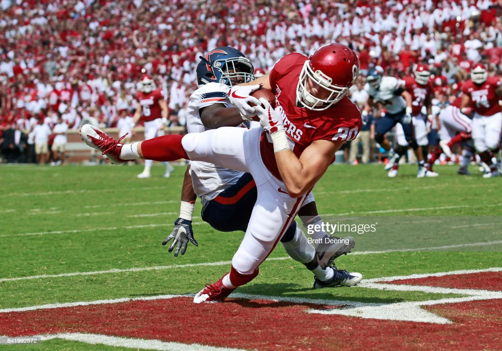 Tight end Grant Calcaterra #80 of the Oklahoma Sooners catches a pass for a touchdown against the UTEP Miners at Gaylord Family Oklahoma Memorial Stadium on September 2, 2017 in Norman, Oklahoma.