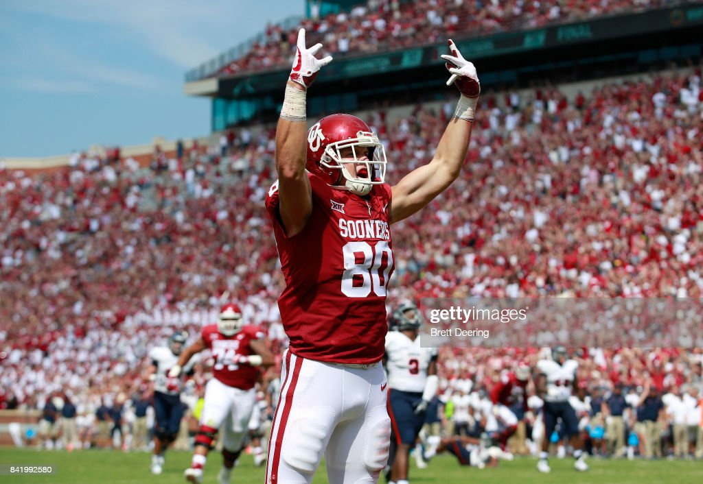 Tight end Grant Calcaterra #80 of the Oklahoma Sooners celebrates a touchdown against the UTEP Miners at Gaylord Family Oklahoma Memorial Stadium on September 2, 2017 in Norman, Oklahoma. Oklahoma defeated UTEP
