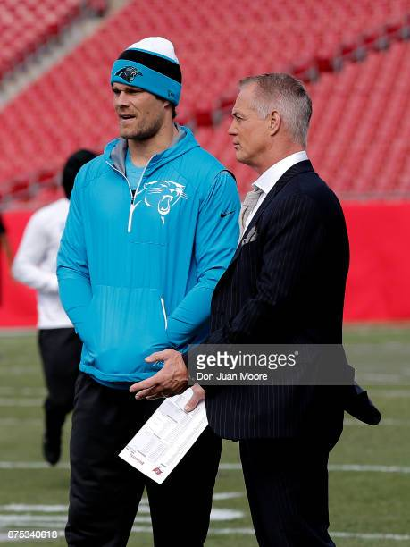 Tight End Greg Olsen of the Carolina Panthers talk with Fox NFL Analyst Daryl Johnson on the field before the game against the Tampa Bay Buccaneers...