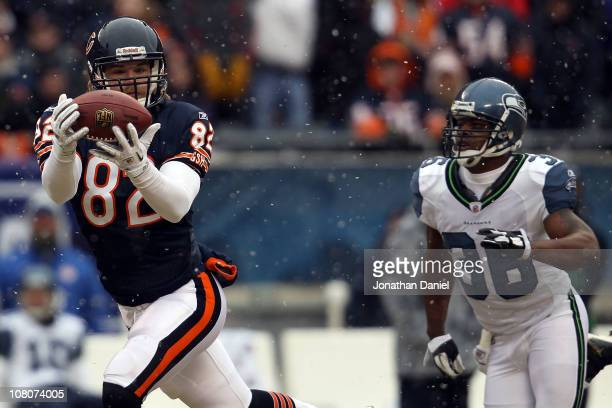 Tight end Greg Olsen of the Chicago Bears catches a 58-yard touchdown in the first quarter in front of Lawyer Milloy of the Seattle Seahawks in the...