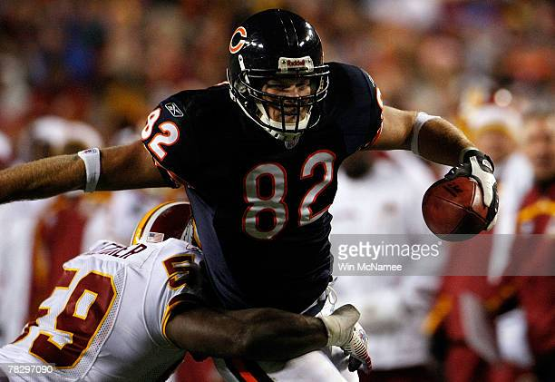 Tight end Greg Olsen of the Chicago Bears is tackled by linebacker London Fletcher of the Washington Redskins in third quarter action at FedEx Field...