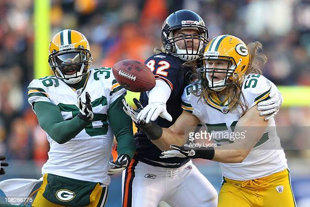 Tight end Greg Olsen of the Chicago Bears knocks down a pass intended for him that was nearly intercepted by Nick Collins and Clay Matthews of the...