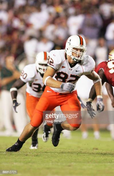 Tight end Greg Olsen of the Miami Hurricanes comes off the line and looks for a block against the Florida State Seminoles at Doak Campbell Stadium on...
