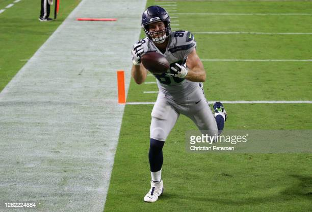 Tight end Greg Olsen of the Seattle Seahawks catches a touchdown pass with one foot down in the end zone in the first quarter of the game against the...