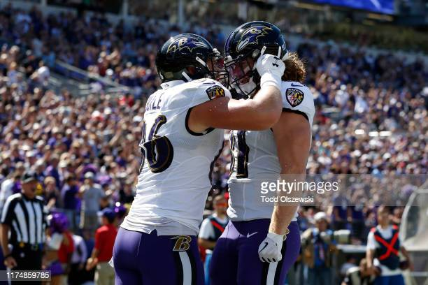 Tight End Hayden Hurst and tight end Nick Boyle of the Baltimore Ravens celebrate after a touchdown against the Arizona Cardinals during the first...