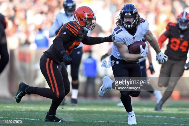 Tight end Hayden Hurst of the Baltimore Ravens carries the ball in the third quarter of a game against the Cleveland Browns on December 22 2019 at...