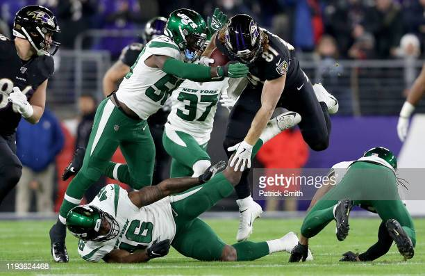 Tight end Hayden Hurst of the Baltimore Ravens carries the ball against the defense of the New York Jets during the game at MT Bank Stadium on...