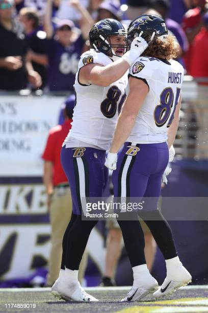 Tight end Hayden Hurst of the Baltimore Ravens celebrates his touchdown with teammate tight end Nick Boyle against the Arizona Cardinals during the...