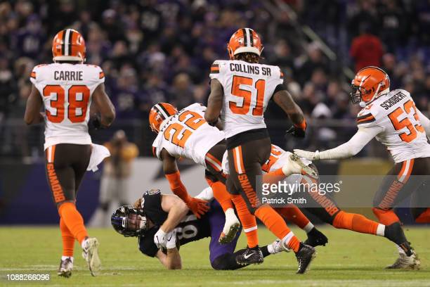 Tight End Hayden Hurst of the Baltimore Ravens is tackled after a reception in the fourth quarter against the Cleveland Browns at MT Bank Stadium on...