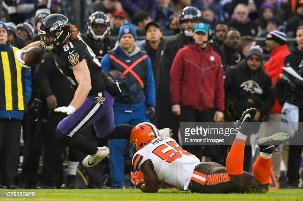 Tight end Hayden Hurst of the Baltimore Ravens is tackled by outside linebacker Genard Avery of the Cleveland Browns in the first quarter of a game...