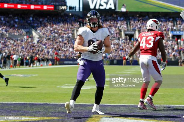Tight End Hayden Hurst of the Baltimore Ravens scores a touchdown against the Arizona Cardinals during the first half at MT Bank Stadium on September...