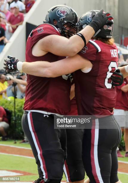 Tight end Hayden Hurst of the South Carolina Gamecocks is congratulated by offensive lineman Blake Camper after scoring a touchdown against the...